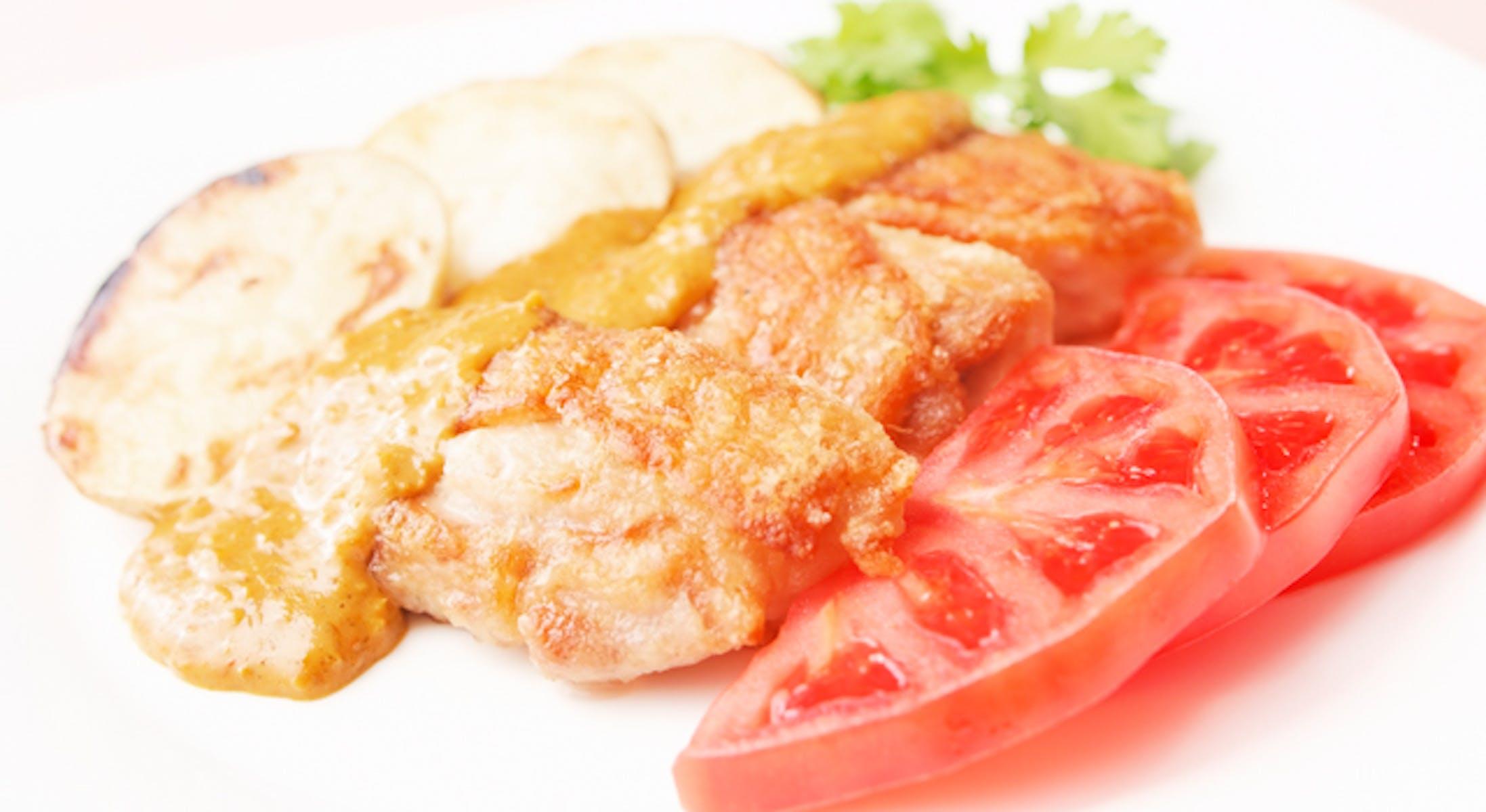 鶏肉の炒り焼きのカレーソースがけ